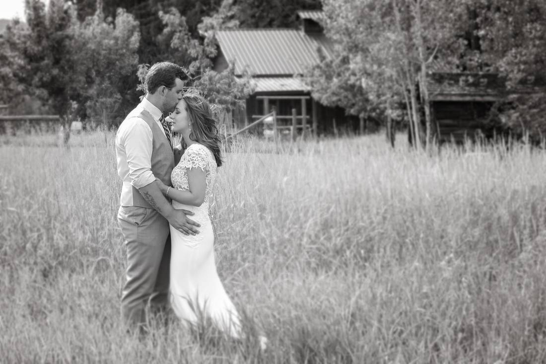 Black and White image of man holding his bride