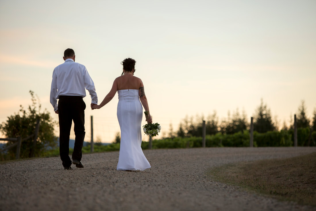 Couple walking hand in hand sunset background